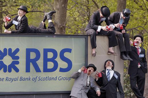 Protesters dressed as oil addicted bankers outside the Royal Bank of Scotland AGM in Edinburgh. Photo: PA