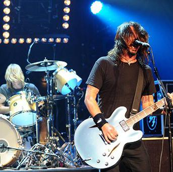 Foo Fighters have toppled Adele from her record-breaking stint at the number one spot in the album charts