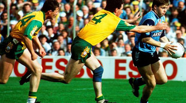 Dublin's Dessie Farrell in action against Donegal's Barry McGowan (4) and John Duffy, left during the National League final of 1993.