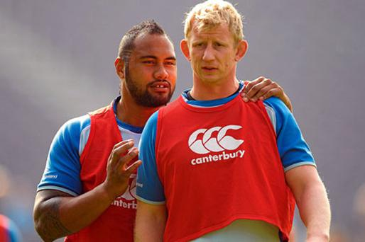 Leinster's Leo Auva'a has a quiet word with Leo Cullen during yesterday's training session at the RDS ahead of their trip to Aironi on Saturday. Photo: Paul Mohan / Sportsfile