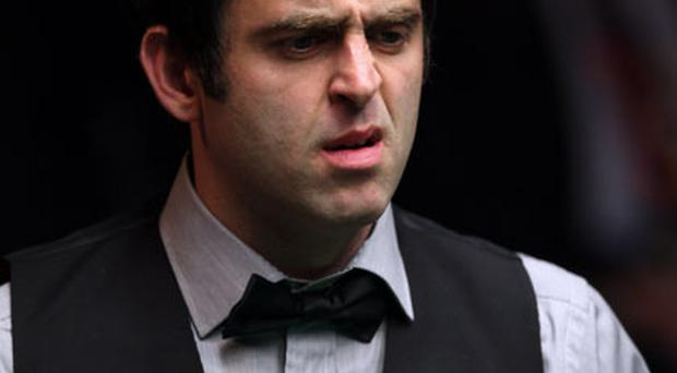 Ronnie O'Sullivan looks perplexed during his 10-2 victory over Dominic Dale in the first round of the World Snooker Championships. Photo: Getty Images