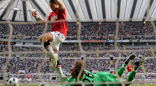 Manchester United's Javier Hernandez (L) jumps over Tim Krul after the Newcastle United keeper saved his shot in the opening minutes of last night's clash. Photo: Getty Images