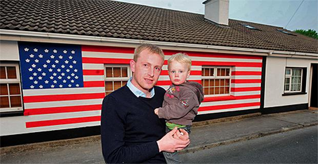 Jason Austin and son Matthew, by their home in Moneygall, Co Offaly