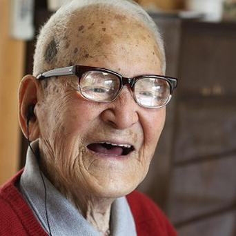 Jirouemon Kimura celebrates his 114th birthday at his home in Kyotango, Japan (AP)