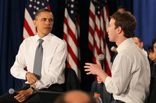 US President Barack Obama talks with Facebook CEO Mark Zuckerberg during a town hall style meeting at Facebook headquarters on April 20 in Palo Alto, California. Obama held the Facebook town hall to answer questions about the deficit and the economy. Photo: Getty Images