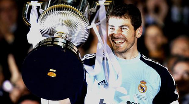 Real Madrid's captain Iker Casillas raises the trophy. Photo: Reuters