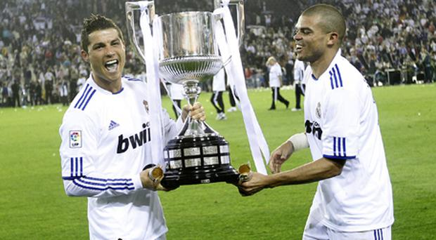 Real Madrid's Cristiano Ronaldo and defender Pepe celebrate after winning the Copa Del Ray. Photo: Getty Images