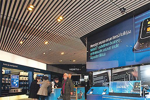 The latest Nokia E7 handsets sit on display inside a Nokia Oyj mobile phone store yesterday in Helsinki, Finland