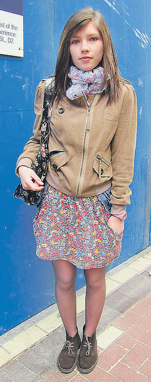 Anais works laid-back layers with her punched suede biker jacket, mixed florals and on-trend desert boots