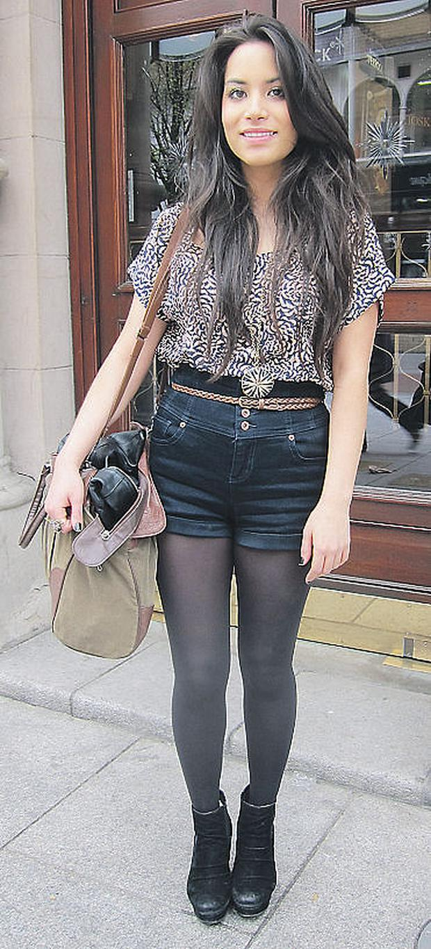 Rebecca offsets her fitted, high-waisted shorts with a blouson top and platform wedges