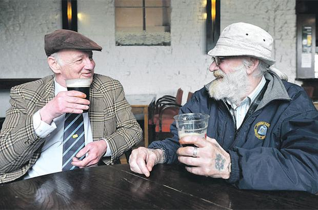 John Connor, left, from Ringsend, Dublin, and John Geoghan, from Spencer Dock in Dublin, enjoy a Good Friday pint at Connolly Train Station yesterday. Photo: DAMIEN EAGERS