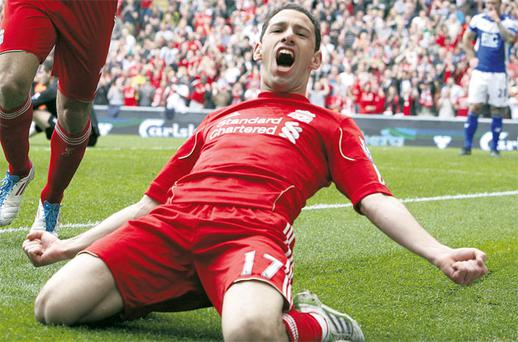 Hat-trick hero Maxi Rodriguez celebrates after scoring for Liverpool in their Premier League clash with Birmingham at Anfield