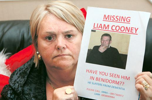 Ann Cooney with a poster of her husband Liam, who suffers from dementia and has gone missing in Benidorm