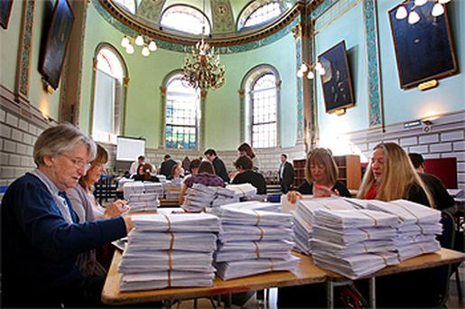 Workers sort out ballots for the Dublin University constituency in the Seanad elections in TCD yesterday. Photo: Tom Burke