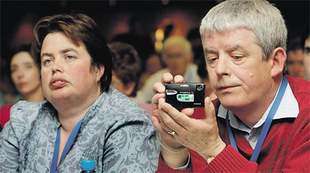 Vivienne Keenan and Mervyn Griffin, both representing the Offaly branch, listening to Education Minister Ruairi Quinn at the TUI annual congress in Tralee yesterday. Photo: Steve Humphreys
