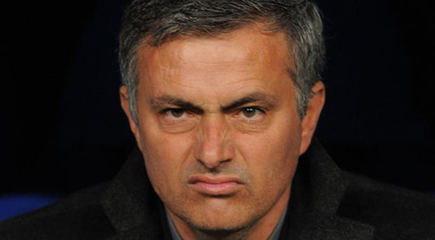 Mourinho last night implied the Catalan giants receive favourable treatment from referees and claimed the club had yet to win a 'clean' Champions League title under Pep Guardiola. Photo: Getty Images