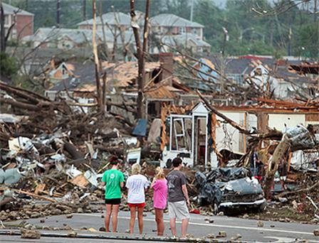 Residents survey damage caused by a huge tornado in Tuscaloosa, Alabama. Photo: AP