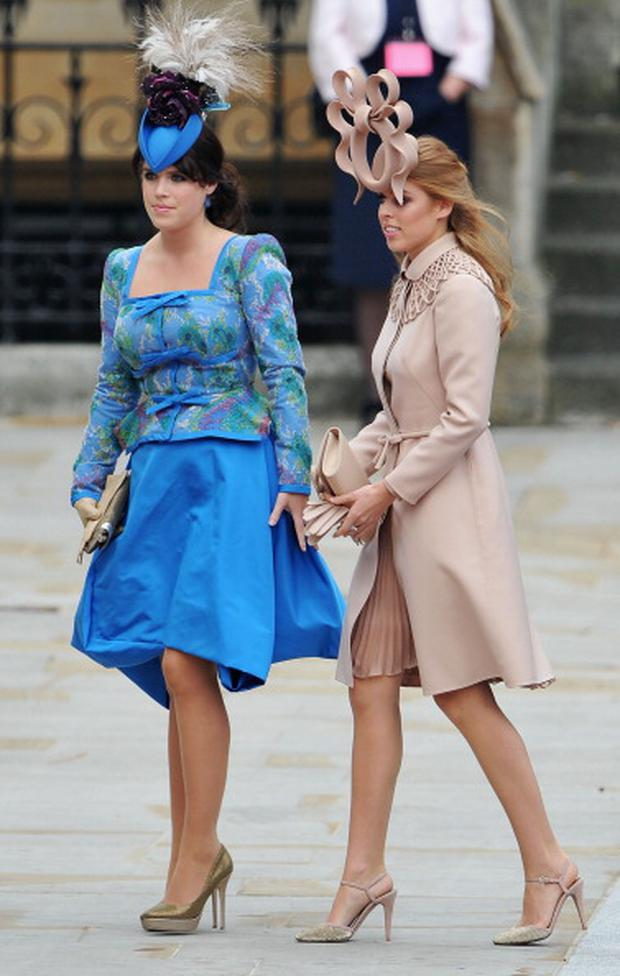Princess Eugenie of York (L) and Princess Beatrice of York arrive to attend the Royal Wedding of Prince William to Catherine Middleton at Westminster Abbey on April 29, 2011 in London, England