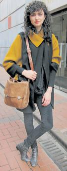 Maria nails the block-colour trend with her vintage coat while her butter-soft satchel lends a luxe edge.