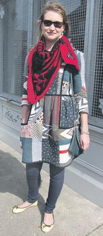 Críona clashes patterns with her patchwork print dress and graphic knit scarf.