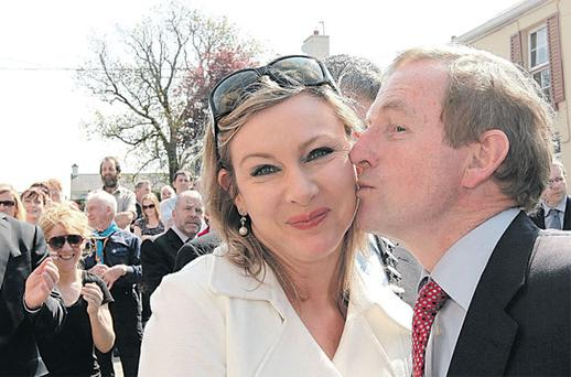 Enda Kenny has a kiss for newly elected Senator Imelda Henry, at the opening of a youth cafe in Drumshanbo, Co Leitrim, yesterday
