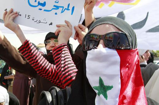 ANGER: Protesters take part in a demonstration in front of the Syrian embassy in Jordan