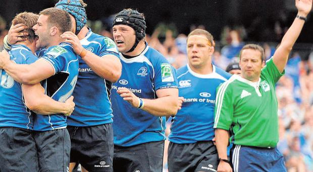 Leinster players congratulate Brian O'Driscoll after he scored his side's crucial second try in the Heineken Cup semi-final win over Toulouse at the Aviva Stadium yesterday. Photo: Brendan Moran