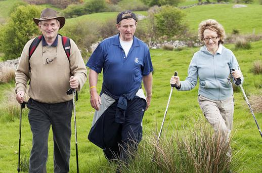 SPIN: Enda Kenny, pictured on the Tochar Padraig Walk, Co Mayo, was presented as a tough guy who would take no messing from judges