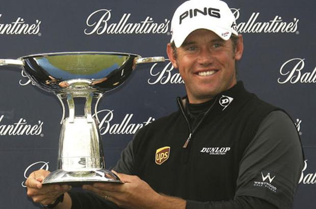 World No 1 Lee Westwood holds the winning trophy after capturing the Ballantine's Championship in South Korea. Photo: AP