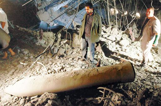 A missile which the Libyan government said was from a NATO air strike in the house of a son of leader Muammar Gaddafi. Photo: REUTERS/LOUAFI LARBI