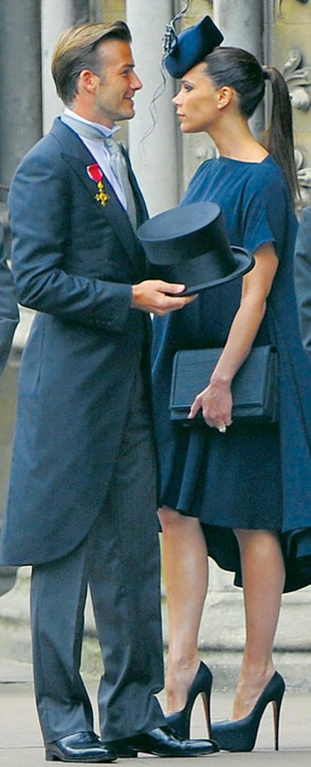 David and Victoria Beckham arrive to attend the royal wedding