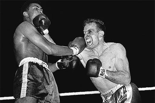 Muhammad Ali fights Henry Cooper at Wembley, London, in 1963