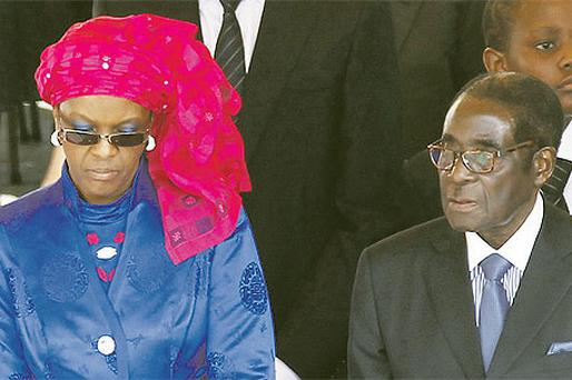 Robert Mugabe and wife Grace at a Mass for John Paul II on Sunday