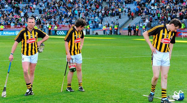Kilkenny's Eddie Brennan, John Mulhall and TJ Reid show their disappointment.