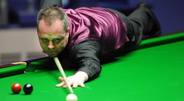 John Higgins at the table during the final at the World Snooker Championships at the Crucible yesterday as he clinched his fourth title. Photo: PA