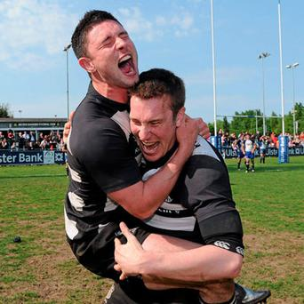 Old Belvedere's David Morgan (left) and Conal Keane show their emotions as they celebrate their victory in Sunday's Ulster Bank League Division 1 final at Donnybrook.