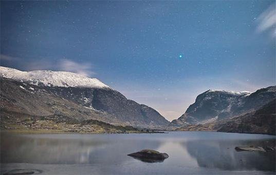 A night-time view of the Gap of Dunloe, illuminated by moonlight