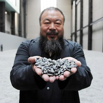 A yoga teacher walked naked across missing artist Ai Weiwei's 'landscape of sunflower seeds' after being inspired by his work