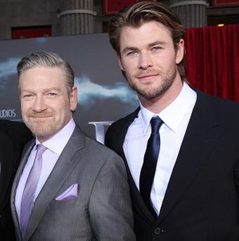 Kenneth Branagh says Chris Hemsworth was happy to show off his 'god-like' physique in Thor