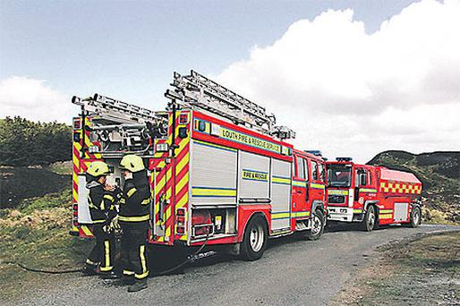 Firefighters from Carlingford, Co Louth, tackle blazes in the Cooley Mountains north of Dundalk yesterday