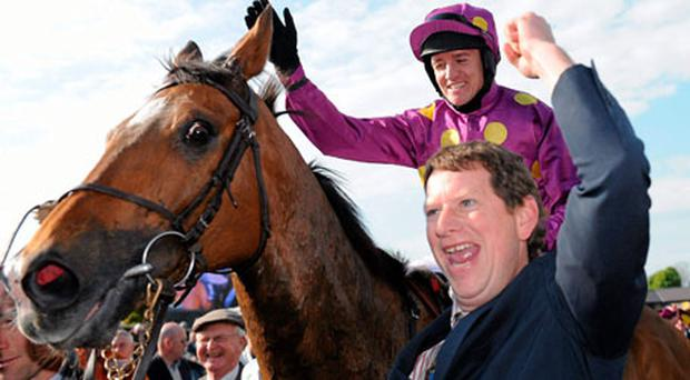 Big Zeb and Barry Geraghty are led into the winner's enclosure at Punchestown yesterday.