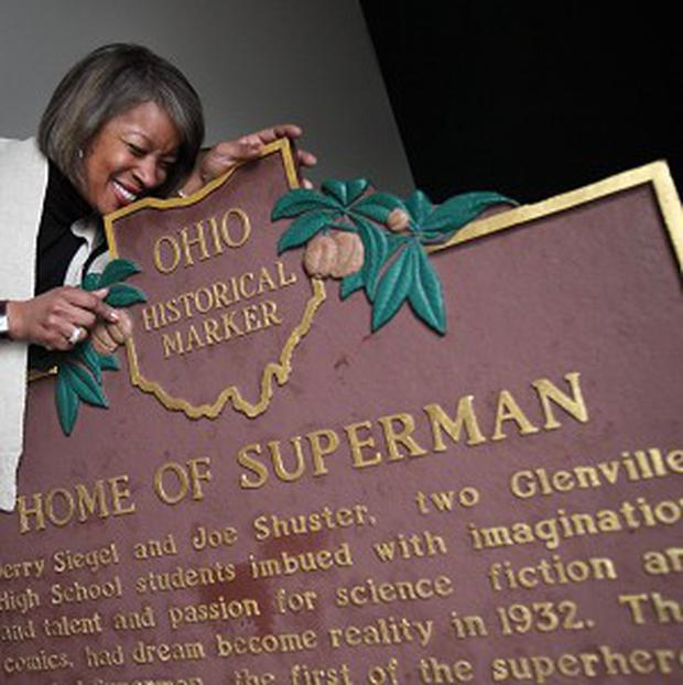 Tracey Kirksey is overjoyed as the plaque honouring the creators of Superman is returned in Glenville, Ohio (AP)