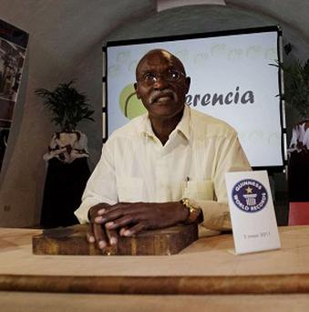 Cuban cigar-maker Jose 'Cueto' Castelar hopes that a 265ft super-stogie he rolled is also a world record (AP)