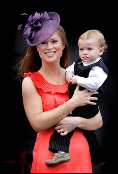 Winner of the Arnotts Best Dressed Lady Competition at the Irish National Hunt Festival at Punchestown yesterday was Katie Smith from Waterford pictured with her 18 month old son Liam.Pic Steve Humphreys3rd May 2011.