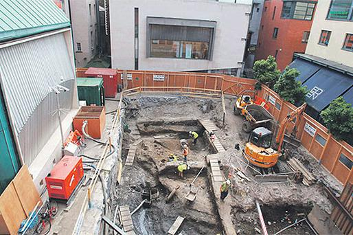 Archaeologists uncovering the Viking settlement at Meeting House Square in Dublin's Temple Bar yesterday