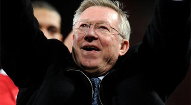 Alex Ferguson celebrates at Old Trafford on Wednesday night after Manchester United booked their Champions League final spot