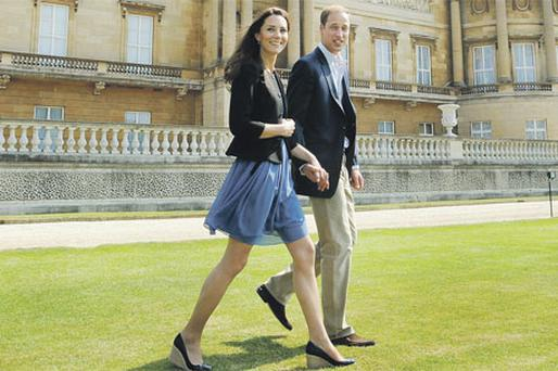 William and Kate, the new Duke and Duchess of Cambridge, walk hand in hand from Buckingham Palace in London the day after their wedding
