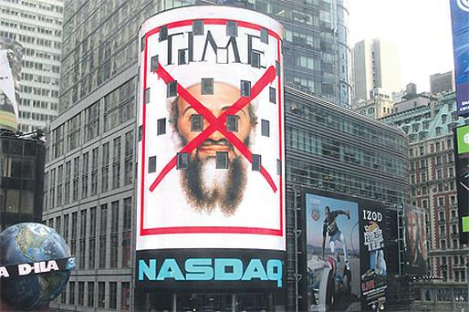 The cover of 'Time' magazine shown on an electronic billboard in Times Square in New York this week