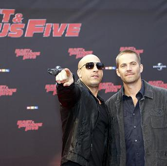 Vin Diesel and Paul Walker star in Fast Five