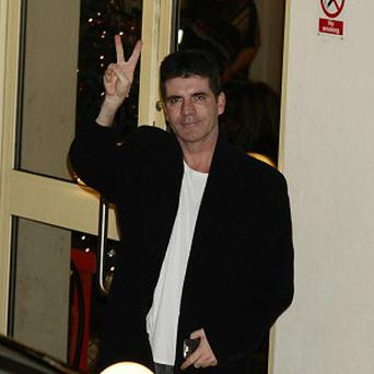 Simon Cowell has plans for an international music show similar to axed television institution Top of the Pops